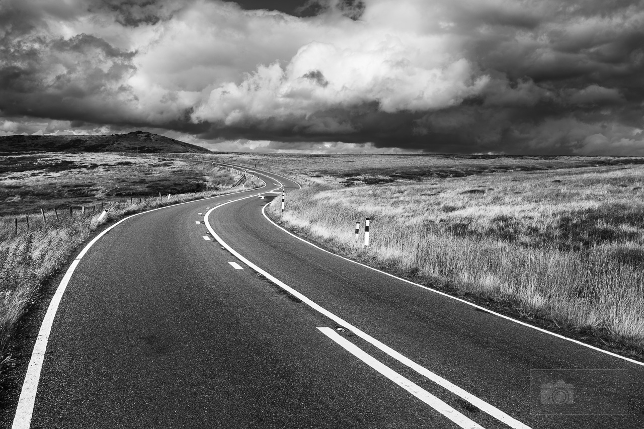 peak district in black and white winding road